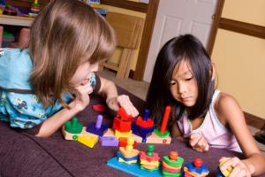 young girls playing with blocks