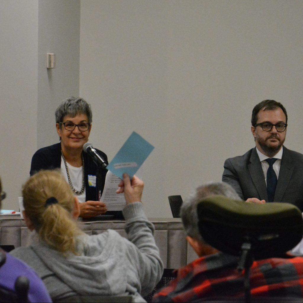 Monica Ackermann and Robert Lattanzio on panel table